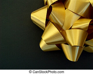 gold bow on black