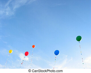 Coloful balloons in blue sky background - Background of...