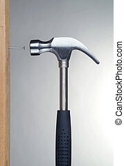 hammer and nail - vertical image