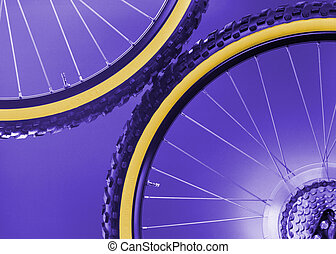 bike's wheels - particular on blue background