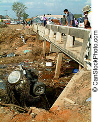 car in river under bridge after tsunami, khao lak, Thailand