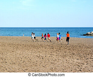 Children running on the beach on a bright summer day