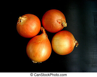 Onions on black background - 4 isolated onions on black...