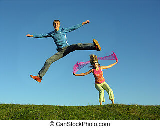 couple jump on grass - couples jump on grass
