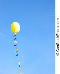Yellow balloon in blue sky - Yellow balloon flying in the...