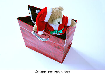 santa teddy in bag - santa teddy sitting in the top of a...