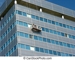 Window washers on office building - Window washers on the...
