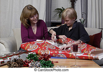 Wrapping Presents - A mother teaches her son how to wrap...