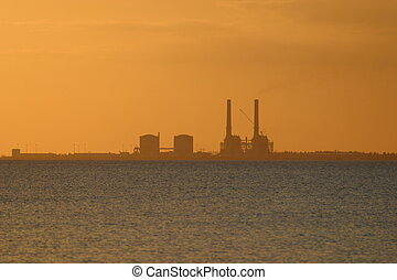 Nuclear Power Plant - Nuclear power plant at sunset from...