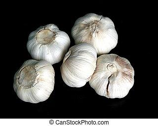 Garlic bulbs on black