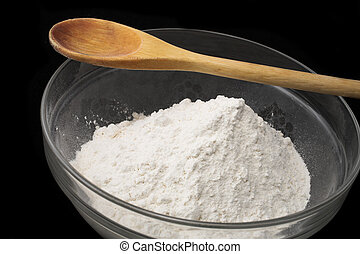Baking 3 - Cake Flour inside a glass mixing bowl with wooden...