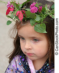 Faerie Child - Beautiful green-eyed child wearing a garland...