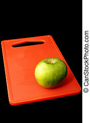 Apple #6 - Red apple on red cutting board - black background