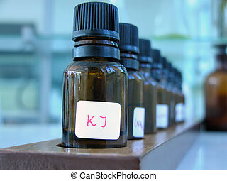 Substances - Little bottles with substances row in a...