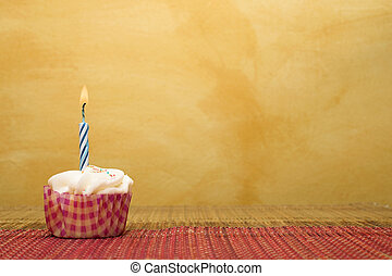 Cupcakes #1 - one cupcake on pink and brown table cloth in...