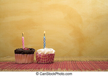 Cupcakes 9 - two cupcakes on pink and brown table cloth in...