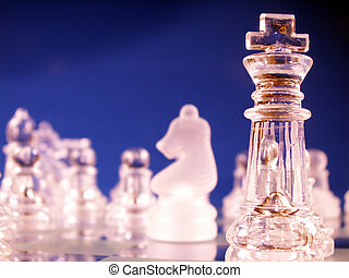 king in focus on chess board