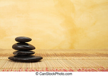massage 38 - hot stone massaging stones on bamboo cloth in...