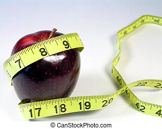 apple with yellow tape measure - apple on white with...