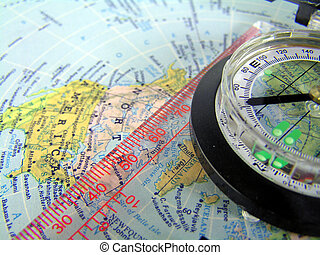 compass on map - compass with ruler on a map of the americas...