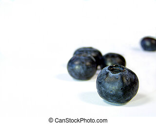 blueberry focus - closeup of blueberries isolated on white...