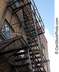 out the back door - fire escape in the city with blue sky...