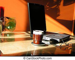 working early 2 - a laptop computer, glasses and a cup of...