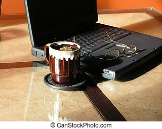 working early 4 - a laptop computer, glasses and a cup of...