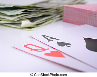 winning hand - ace of spades and queen of hearts with money...
