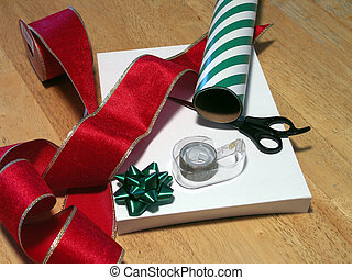 wrapping gifts - scissors, tape, ribbon and wrapping paper...