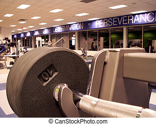 fitness center - empty fitness center with freeweights in...