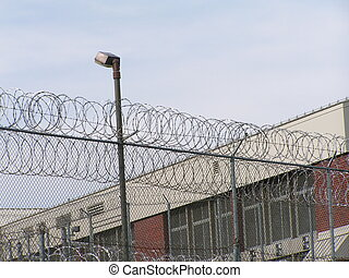 lockdown - fence and lights around a jail