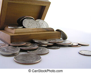 nest egg - wooden box with coins spilling out suggesting...