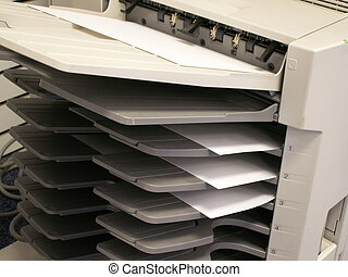 copy machine - a copy machine with copies in tray