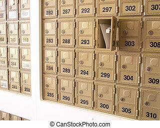 mailboxes - letters in an open mailbox in a wall of...