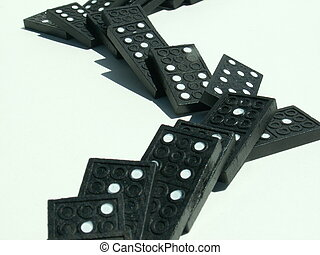 dominoes falling - a line of dominoes isolated on white...