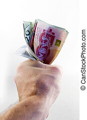 Fist full of Canadian Money - A male hand holding a tight...
