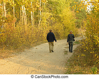 Autumn walk - Couple walking in forest