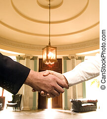 Handshake - Male and female shaking hands