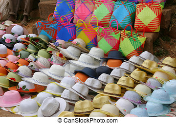 Collection of hats and bags at a market in madagascar