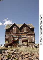 Victorian house 1 - Victorian-era log cabin, topped with a...