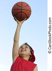 Boy with a basketball - Boy in red shirt with a basketball...