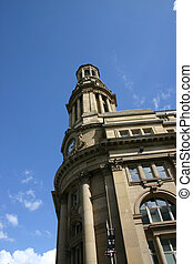 Old Building with Clock in Manchester