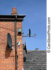 3 Satellite Dishes - 3 Small Satellite Dishes on the SIde of...