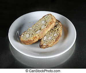 Biscotti on a plate on an aluminum table