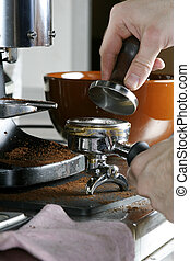 Tamping Espresso - Tamping the espresso after dosing and...