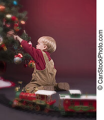 Boy and Christmas Tree - Youngster playing with decorated...