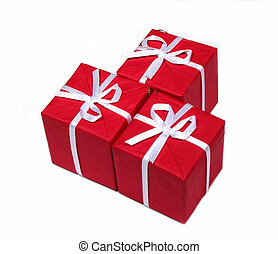 Red gift boxes - Three bright red gift boxes isolated on...