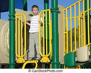 Not so bad - Boy not scared at top of playground ladder