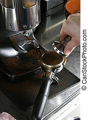 Tamping Espresso Grounds - Detail image of tamping espresso...